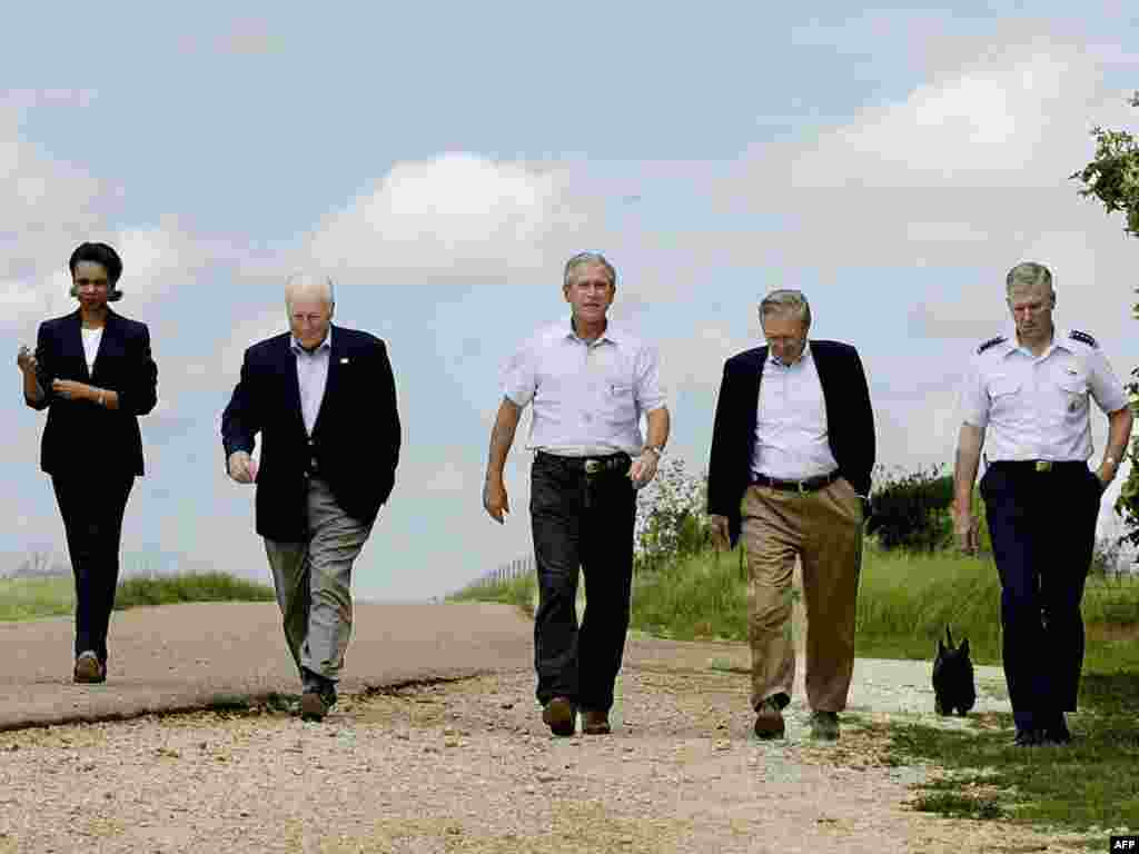 Bush's staff - U.S. President George W. Bush (center), Vice President Dick Cheney (2nd-left), Defense Secretary Donald Rumsfeld (2nd-right), Chairman of the Joint Chiefs of Staff General Richard Myers (right) and national security adviser Condoleezza Rice (left) walk out to address reporters on August 23, 2004, at Bush's ranch in Crawford, Texas. The group was at the ranch for Bush's Defense Policy and Program Teams meeting held annually at the ranch.