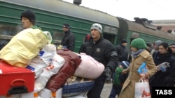 İşsiz miqrantlar Moskvanı tərk edirlər. 15 dekabr 2008