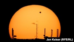 Venus transits the sun, as seen from Prague in a photograph taken by RFE/RL's Jan Kaiser.