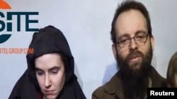 A video posted by the Taliban on social media on December 19, 2016 shows American Caitlan Coleman (left) speaking next to her Canadian husband, Joshua Boyle, and their two sons.