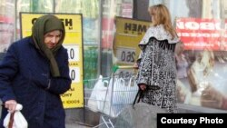 Russia - - Old poor women near the door of food market in Moscow- 2007