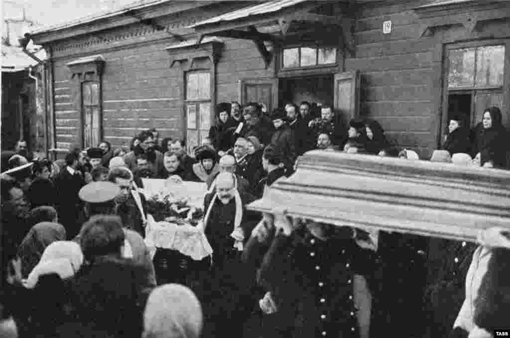 "Tolstoy's body is carried out of a railway station in Russia's Lipetsk region, where the famed writer died. Amid an outpouring of grief around the world, Russia's Tsar Nicholas II wrote: ""I sincerely regret the death of the great writer, who, during the height of his talent, reflected in his works images of the most glorious years of Russian life. May the Lord God be a merciful judge to him."""