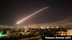 The Damascus sky lights up missile fire as the U.S. launches an attack on Syria targeting different parts of the capital early on April 14.