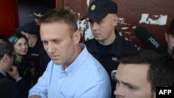 Russian opposition leader Aleksei Navalny (left) spoke at the rally. (file photo)