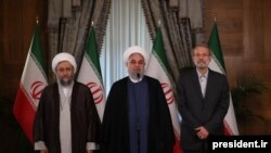 (From L to R) Head of Iran's Judiciary Sadeq Larijani, President Hassan Rouhani and Parliament Speaker Ali Larijani.
