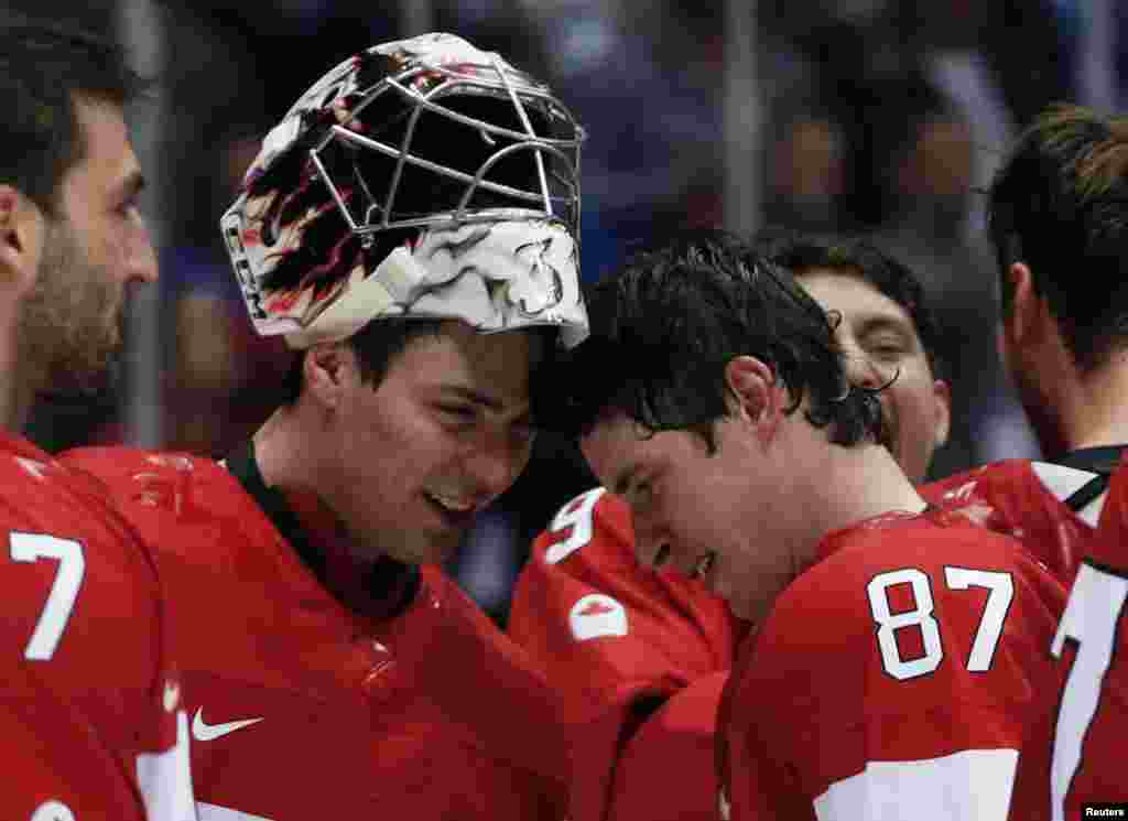 Canada's goalie Carey Price (left) and Sidney Crosby bump heads after winning their men's ice hockey gold medal match against Sweden. (Reuters/Gary Hershorn)