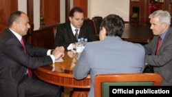 Armenia -- Defense Minister Seyran Ohanian (L) meets with Frank Boland, a senior official from NATO's Defense Policy and Planning Division, 8Apr2011.