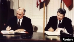 U.S. President Ronald Reagan (right) and Soviet President Mikhail Gorbachev sign the Intermediate-Range Nuclear Forces (INF) treaty at the White House on December 8, 1987.
