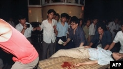 A girl wounded during the clash between the army and students is carried out of Tiananmen Square in 1989.