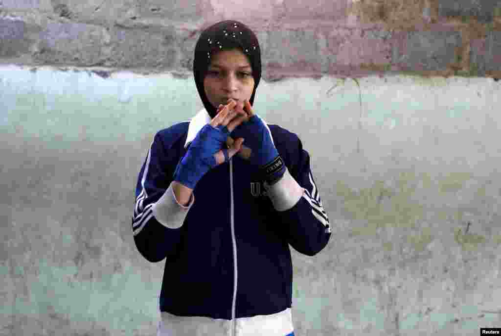 Azmeena, 16, takes part in warm up exercises.