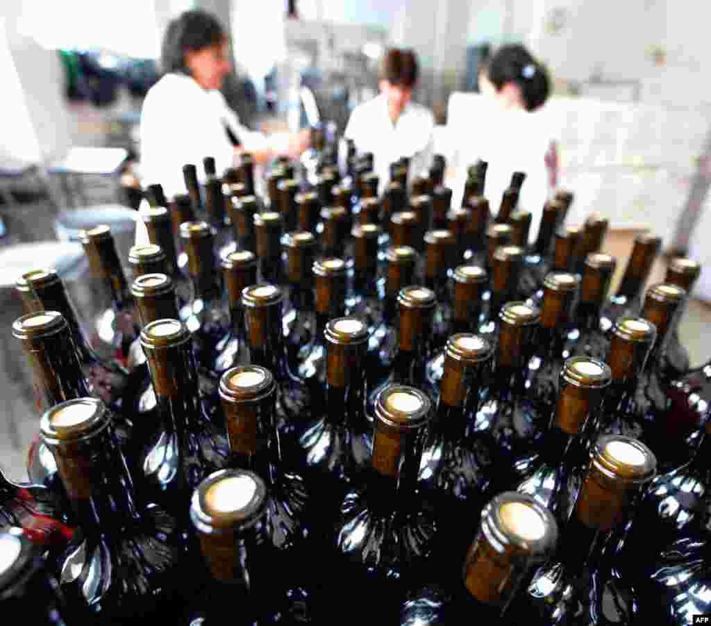 Bottles move along a conveyor belt at a wine factory in Lilo near Tbilisi, Georgia. The first batch of Georgian wine has been allowed back into Russia seven years after Moscow slapped a ban on Georgian wines amid spiralling tensions that eventually erupted into a brief war in 2008. (AFP/Vano Shlamov)