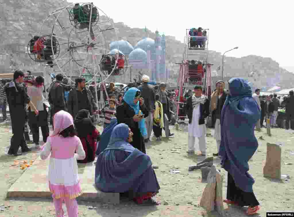 Kabul families attend an amusement park to enjoy the festivities.