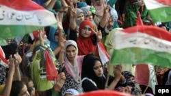 Supporters of opposition cleric Tahirul Qadri listen to him speaking during protests in Islamabad on August 19.