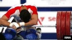 Ауыр атлет. (Көрнекі сурет)
