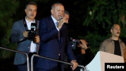 Turkish President Recep Tayyip Erdogan addresses supporters on June 24.