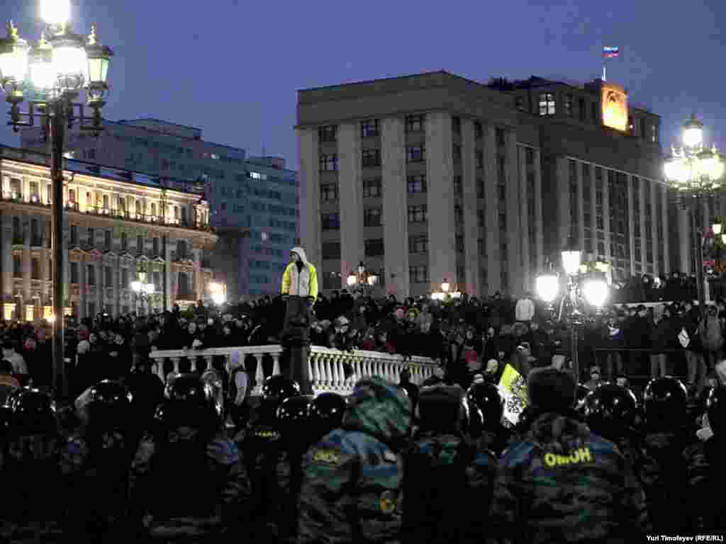Riot police confront soccer fans demonstrating on Moscow's Manezh Square on December 11 in memory of a fellow fan killed the week before. Thousands of ultranationalists and soccer hooligans chanted racist slogans and attacked non-Slavic bystanders in the worst outbreak of racially motivated rioting in the Russian capital since the 1991 Soviet collapse.Photo by Yuri Timofeyev for RFE/RL
