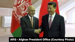 Afghan President Ashraf Ghani (left) meets with Chinese President Xi Jinping.