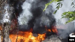 A World Food Program warehouse set on fire by alleged Taliban militants in Swat Valley's Kanju region