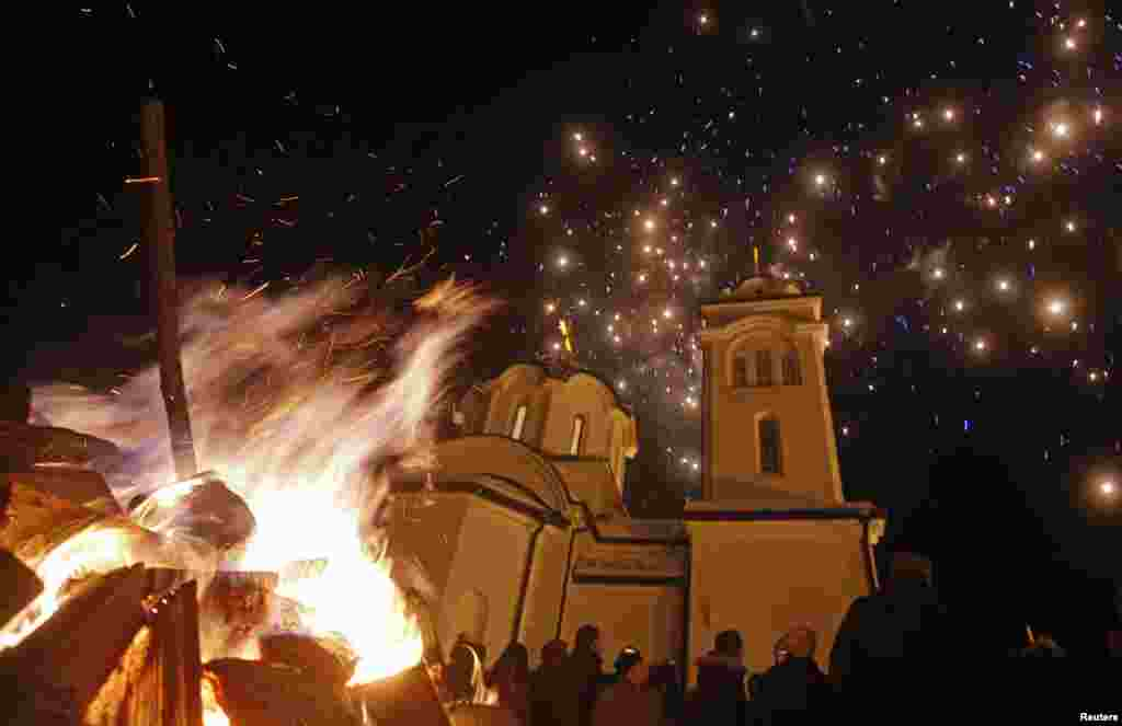 Burning Yule logs and fireworks are seen in front of the Sokolica church on Orthodox Christmas eve, in Ravna Romanija, in Bosnia-Herzegovina.