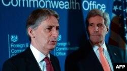 British Foreign Secretary Philip Hammond (left) and U.S. Secretary of State John Kerry