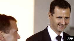 Syrian President Bashar al-Assad (right) and his Russian counterpart, Dmitry Medvedev