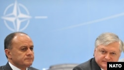 Armenia -- Defense Minister Seyran Ohanian (L) and Foreign Minister Edward Nalbandian (C) at an annual meeting with NATO's North Atlantic Council in Brussels, 12 May 2010.