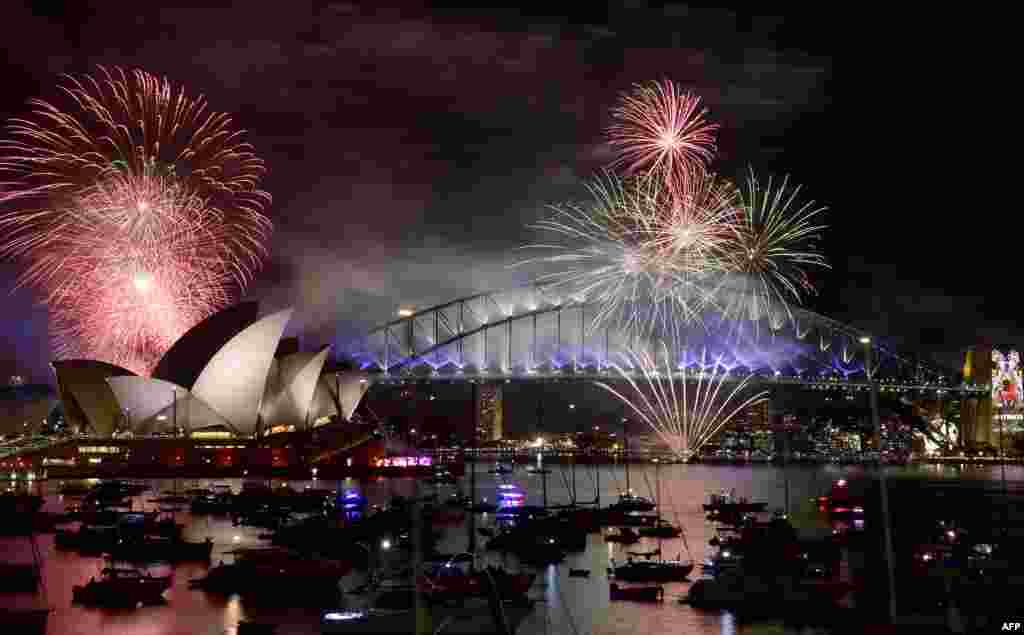 Fireworks light up the sky over Sydney's Opera House and Harbor Bridge during New Year celebrations in Sydney, Australia, on January 1, 2016. (AFP/Saeed Khan)