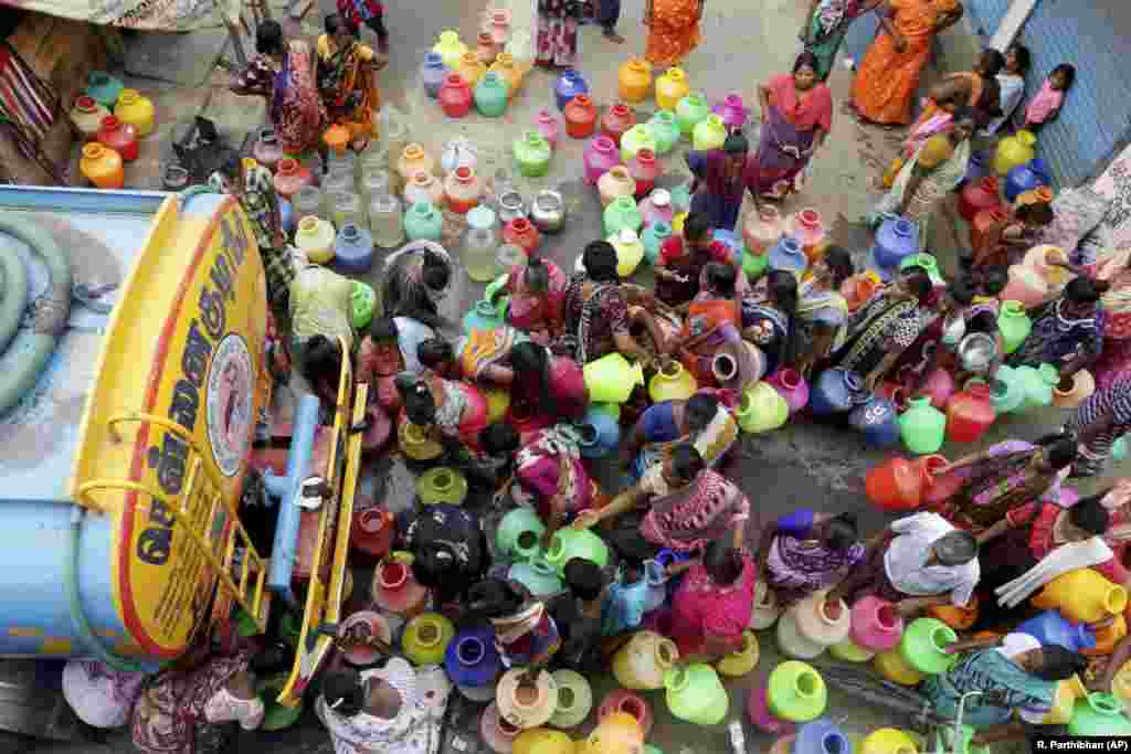 Indians stand in line to fill vessels with drinking water from a tanker in Chennai, capital of the southern state of Tamil Nadu. Millions of people are turning to water trucks in the state as house and hotel taps run dry in an acute water shortage caused by drying lakes and depleted groundwater. (AP/R. Parthibhan)
