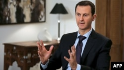 Board members of a Moscow bank have been blacklisted for allegedly providing financial services to the regime of Syrian President Bashar al-Assad (pictured, file photo).