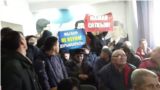 "Kazakhstan - People who against ""Democratic party"" holds banner in Karaganda"