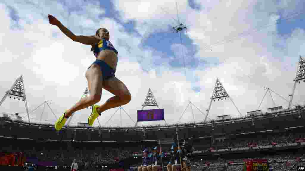 Ukraine's Lyudmyla Yosypenko competes in the women's heptathlon long-jump qualifications at the London Games. (AFP/Adrian Dennis)
