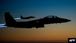 A pair of US Air Force F-15E Strike Eagles fly over northern Iraq. File photo