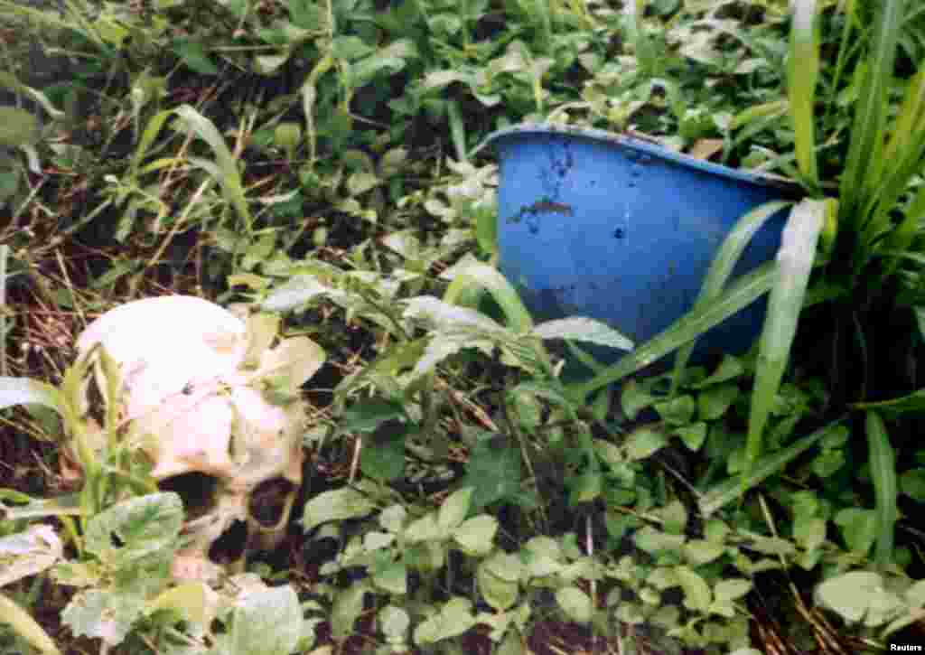 A human skull next to a United Nations helmet found in Sierra Leone. The UN peacekeeping operation in the country ran from 1999 to 2005 and its mission mandate was notable for allowing troops to protect civilians under imminent threat of physical violence.