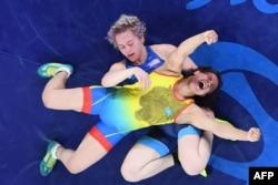 Екатерина Ларионованың Рио олимпиадасында 2012 жылғы әлем чемпионы Елена Пирожкованы жеңген сәті. Бразилия, 18 тамыз 2016 жыл.