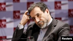 "Iranian Deputy Foreign Minister Abbas Araghchi: The report ""confirms that Iran's program was peaceful."""