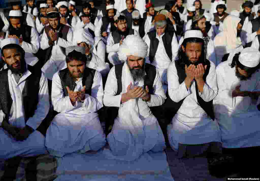 Some of the 900 Taliban prisoners pray on May 26 after being released from Pul-e-Charkhi prison, Afghanistan's largest detention facility.