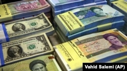 The black-market exchange rate of the Iranian rial to the U.S. dollar has plummeted in recent days. (file photo)