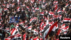 Supporters of Shi'ite cleric Muqtada al-Sadr wave Iraqi flags during a rally in Basra on March 19.