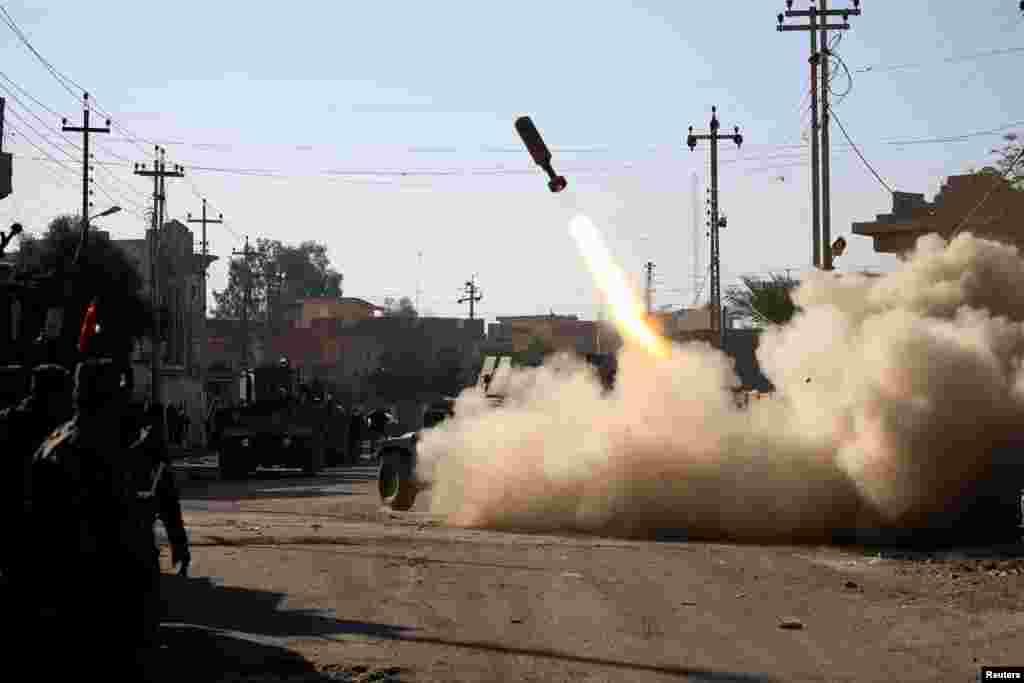 Members of the Iraqi rapid-response forces fire a missile toward Islamic State militants during a battle in the Sumer district of eastern Mosul, Iraq, on January 11. (Reuters/Alaa al-Marjani)