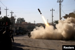 Members of the Iraqi rapid response forces fire a missile toward Islamic State militants during a battle in the Somer district of eastern Mosul on January 11.