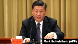 Си Цзиньпин выступает с речью в парламенте Китая. Пекин, 2 января 2019 года