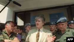 Radovan Karadzic in Pale in 1993, next to fellow UN indictee Ratko Mladic (left)