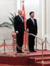 Az akkori kínai alelnök, Li Yuanchao és Joe Biden, akkor még amerikai alelnök egy pekingi ünnepségen, 2013. december 4-én.