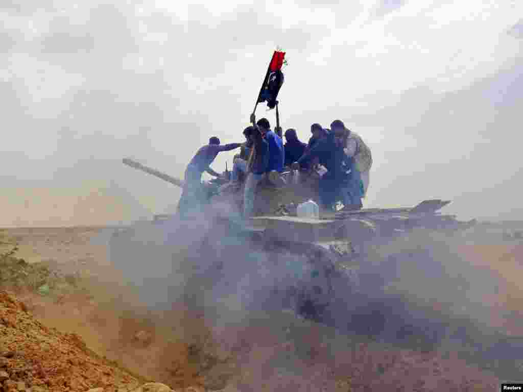 Rebels in Libya ride atop a tank on the outskirts of Ajdabiya, on the road leading to Brega, on March 2. Photo by Goran Tomasevic for Reuters