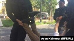 Kazakh police detain a protester in Almaty.