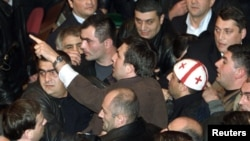 Saakashvili as an opposition leader, giving instructions to his supporters in the Georgian parliament in November 2003