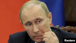 Putin said Iran has Russia's backing as long as its nuclear program is for civilian purposes.