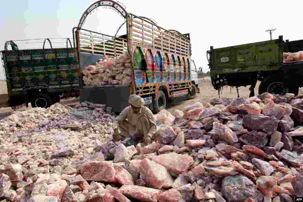 A worker collects salt stones for loading onto a truck outside the Khewra salt mines.