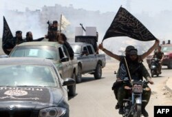 Fighters from the Al-Nusra Front in the northern Syrian city of Aleppo in May 2015