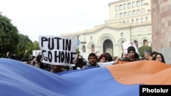 Antigovernment activists demonstrate against Armenia's membership of a Russian-led customs union during a state visit by Russian President Vladimir Putin to Yerevan in December 2013.